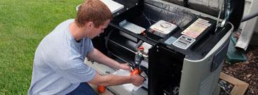 Generator service technician repairs Generac generator