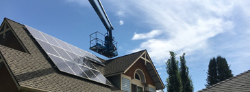 Residential solar power installation with a bucket lift